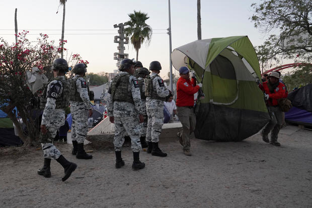 Asylum seekers' tents are relocated near the banks of the Rio Grande in Matamoros