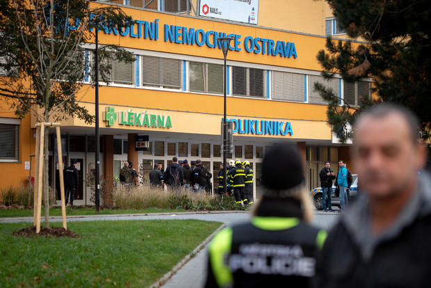 Police officers stand guard near the site of a shooting in Ostrava