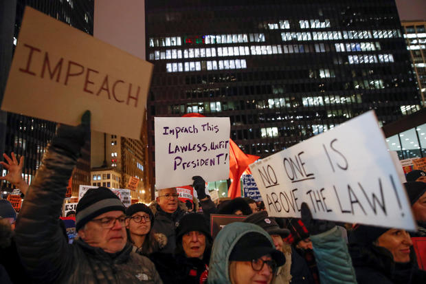 Protesters take part in a rally to support the impeachment and removal of President Trump in Chicago