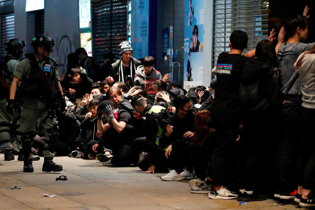 Riot police detain anti-government protesters during a demonstration on New Year's Day to call for better governance and democratic reforms in Hong Kong, China, January 1, 2020.
