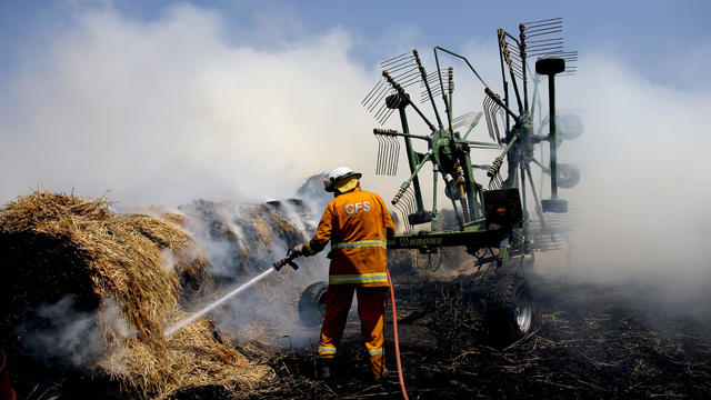 Country Fire Service (CFS) members put out a fire which reached hay bales on a property at Mount Torrens in the Adelaide Hills
