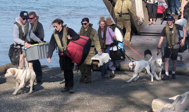 Mallacoota Bushfire Evacuees Arrive On HMAS Choules Following Bushfires
