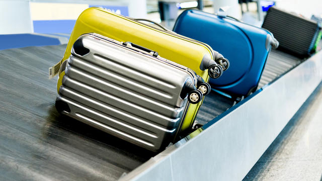 Suitcases on conveyor belt in the airport