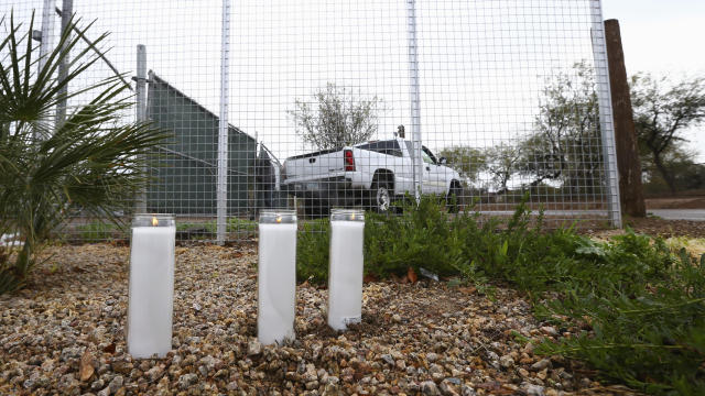 A makeshift memorial is set up near a home where a Phoenix woman was arrested on suspicion of killing her three children, who were found dead inside the family's home, January 21, 2020, in Phoenix.
