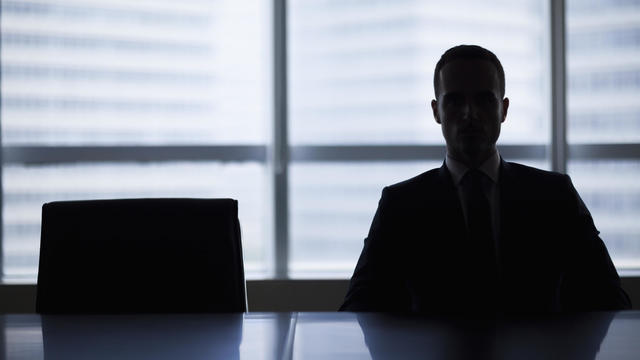 Silhouette of businessman in office meeting room
