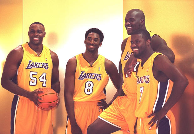 016777.SP.1002.Lakers20.VC A couple of newcomers join a couple of starters for a group portrait duri