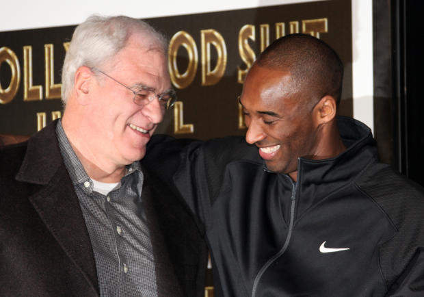 Los Angeles Lakers head coach Phil Jackson and Kobe Bryant attend Bryant's hand and footprint ceremony at Grauman's Chinese Theater on February 19, 2011, in Hollywood, California.