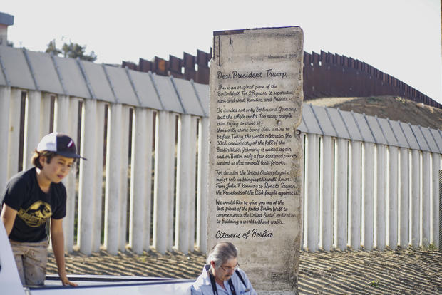Portion Of Berlin Wall With Letter To President Trump Written On Road Goes On Display At U.S. Mexico Border
