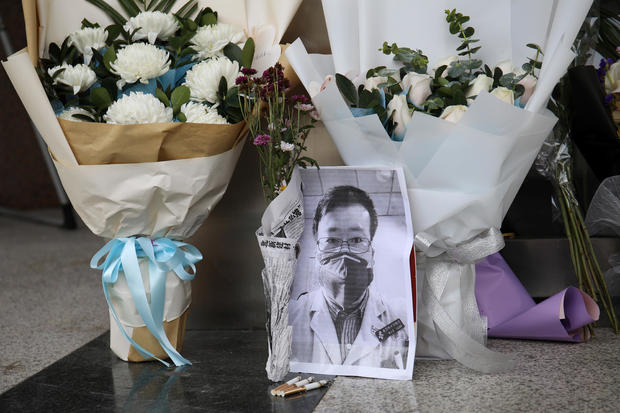A makeshift memorial for Li Wenliang is seen at an entrance to the Central Hospital of Wuhan