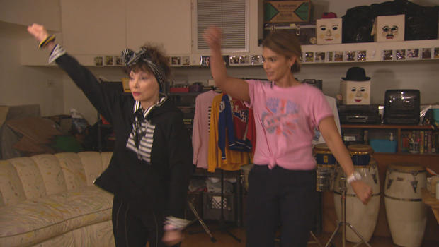 "Toni Basil and Kristine Johnson recreate ""Mickey"" dance moves.  CBS NEWS"