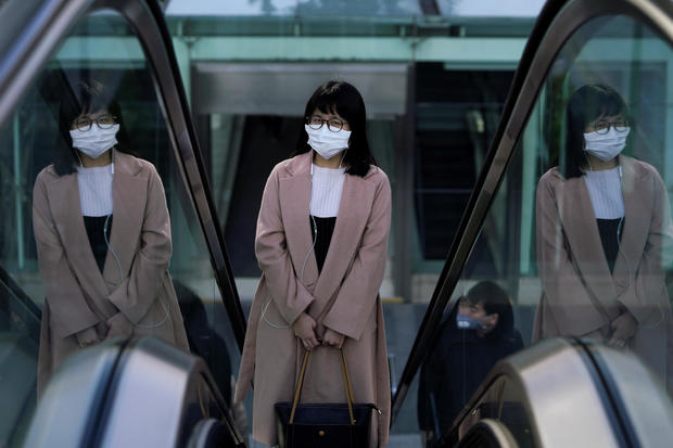 A woman wearing a mask is seen as the country is hit by an outbreak of the novel coronavirus in Shanghai