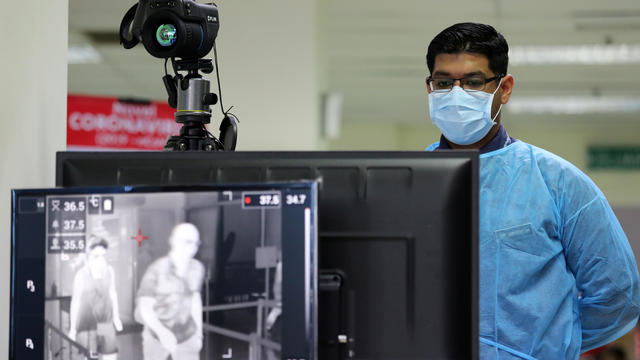 A Malaysian health quarantine officer waits for passengers at a thermal screening point at a cruise ship terminal, following the outbreak of the coronavirus in China, in Port Klang
