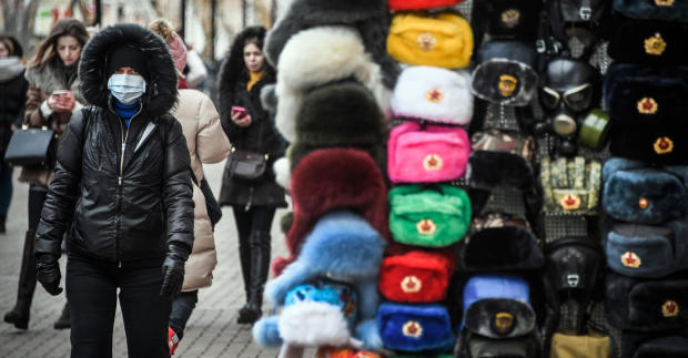 People walk along Arbat pedestrian street in downtown Moscow on February 19, 2020.