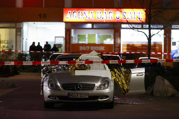 A damaged car is seen after a shooting in Hanau near Frankfurt