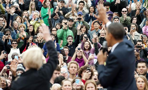 The crowd cheers as US President Barack