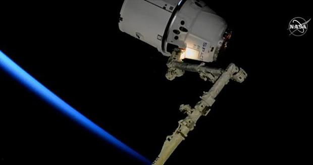 SpaceX cargo ship hooks up with space station