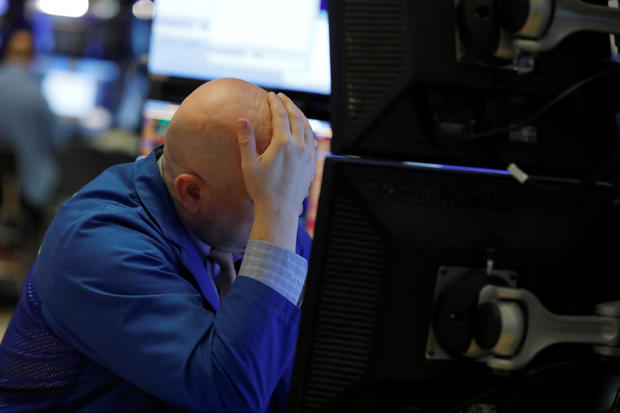 A trader works on the floor of the New York Stock Exchange (NYSE) in New York City, New York