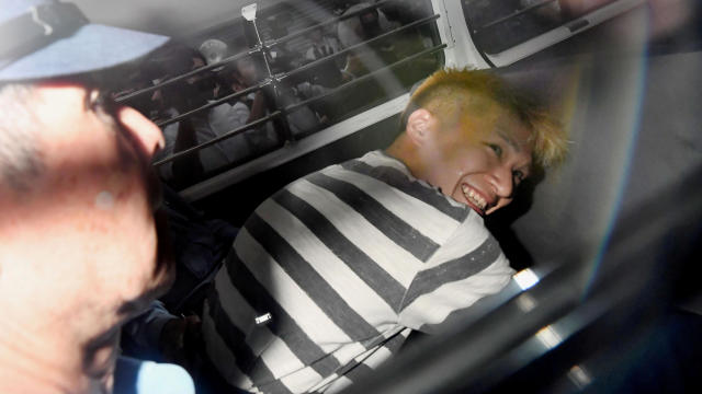 FILE PHOTO : Satoshi Uematsu, suspected of a deadly attack at a facility for the disabled, is seen inside a police car as he is taken to prosecutors, at Tsukui police station in Sagamihara, Japan