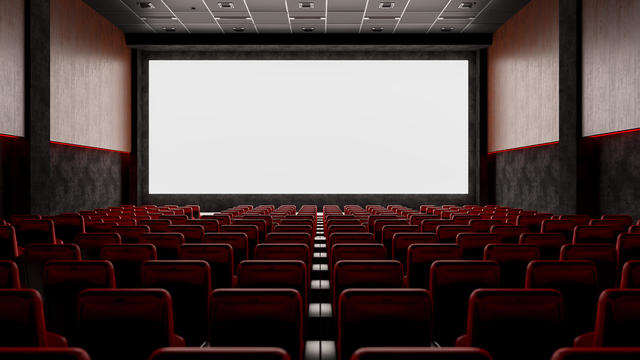 Empty Movie Theater with Red Seats and Blank Screen