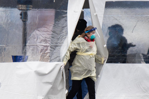 Coronavirus updates: Americans told to hunker down as death toll rises