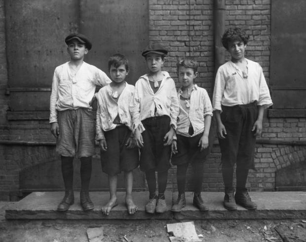 Boys Wearing Bags of Camphor Around Necks
