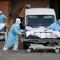 Healthcare workers wheel bodies deceased people from Wyckoff Heights Medical Center during outbreak of coronavirus disease (COVID-19) in New York
