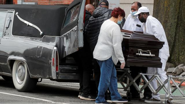 Pallbearer and staff place the body of a deceased family member during a funeral at Jurek-Park Slope Funeral Home during the outbreak of the coronavirus disease (COVID19) in Brooklyn, New York