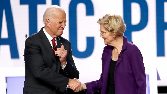 Former Vice President Joe Biden and Senator Elizabeth Warren of Massachusetts greet each other during the Democratic presidential debate at Otterbein University on October 15, 2019, in Westerville, Ohio.