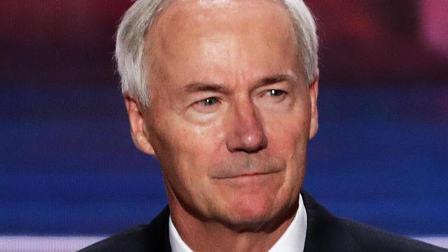 Arkansas Governor Asa Hutchinson stands on stage prior to the start of the second day of the Republican National Convention on July 19, 2016, at the Quicken Loans Arena in Cleveland, Ohio.