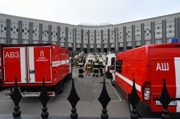 TOPSHOT-RUSSIA-HEALTH-VIRUS-HOSPITAL-FIRE