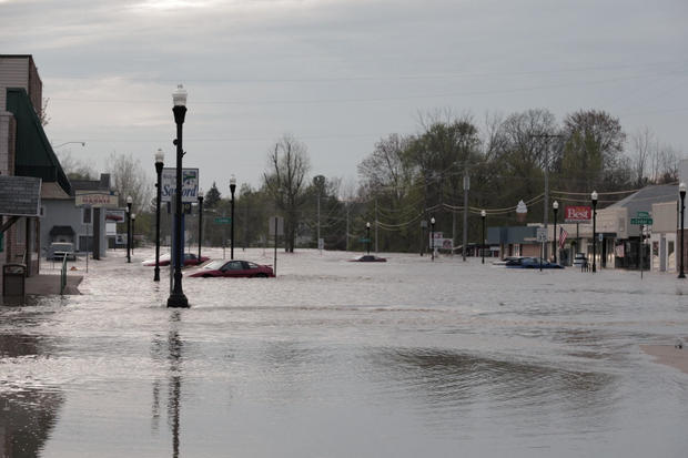 Floodwaters are seen along a street in downtown Sanford, Michigan, U.S. in this May 19, 2020 picture obtained from social media.
