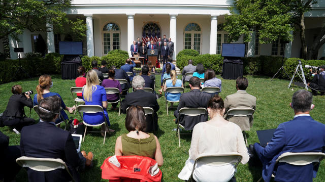 Journalists are seated close together at the White House in Washington