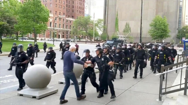 An elderly man appears to be shoved by riot police during a protest over the death of George Floyd in Buffalo, New York, on June 4, 2020, in this still image taken from video.