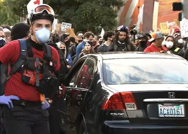 car-is-surrounded-by-grorge-floyd-protesters-in-seattle-shortly-after-it-was-driven-toward-them-on-060720.jpg