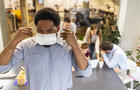 Adult man wearing a pollution mask to protect himself from viruses