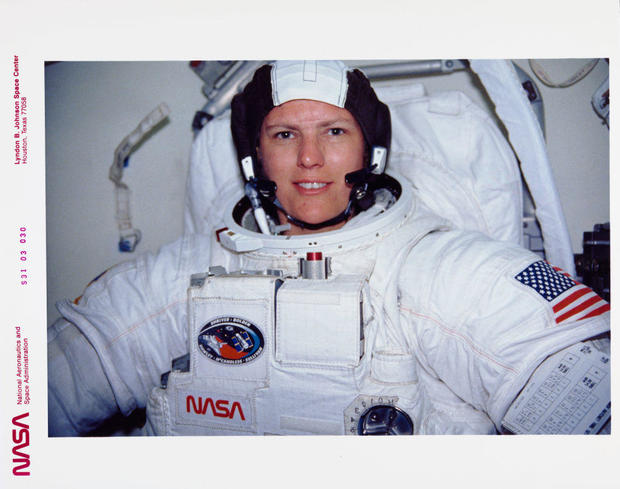 STS-31 MS Sullivan wearing EMU prepares for contingency EVA in OV-103 airlock