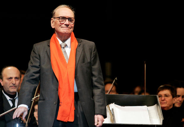 FILE PHOTO: Italian movie composer Morricone conducts the Sinfonietta orchestra during a Christmas concert in Milan