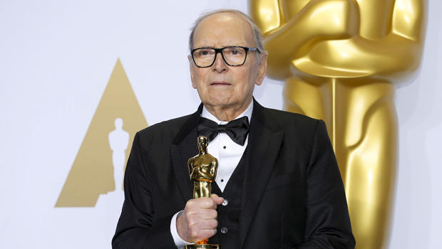 "FILE PHOTO: Italian composer Ennio Morricone poses with his Oscar for Best Original Score for ""The Hateful Eight,"" during the 88th Academy Awards in Hollywood"