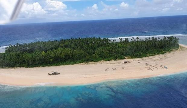 giant-sos-in-sand-leads-to-rescue-of-3-men-from-uninhabited-pacific-isle-pikelot-island.jpg