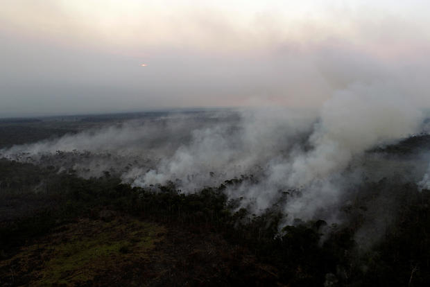 Tract of the Amazon jungle burns as it is cleared by loggers and farmers near Apui