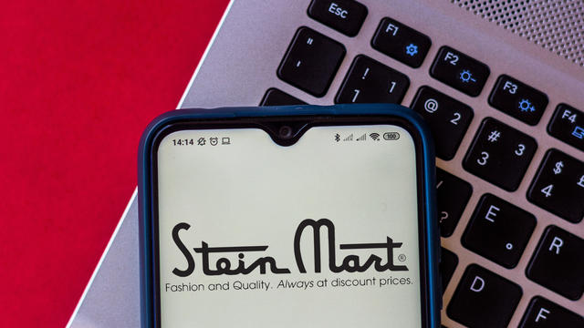In this photo illustration, a Stein Mart logo seen displayed