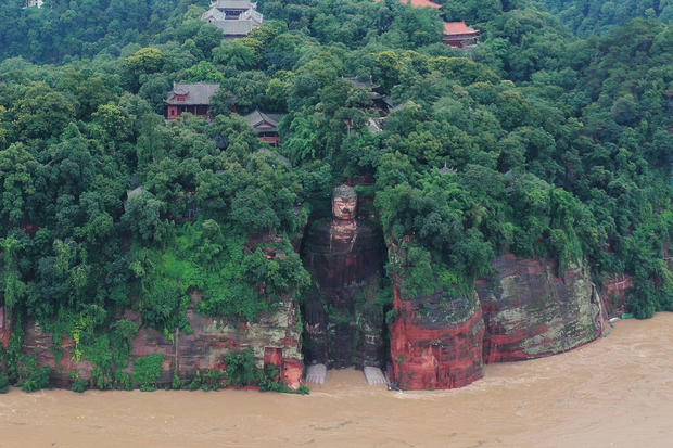 Floodwater reaches the Leshan Giant Buddha's feet following heavy rainfall, in Leshan, Sichuan
