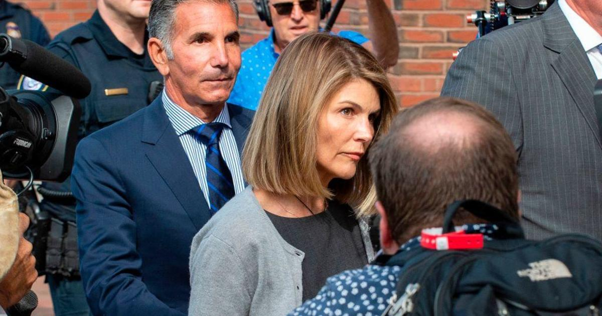 Lori Loughlin sentenced to 2 months in prison in college admissions scandal – CBS News