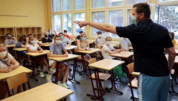 """Pupils of the protestant high school """"Zum Grauen Kloster"""" attend a lesson on the first day after the summer holidays in Berlin"""