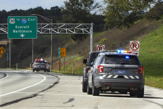 Pennsylvania State troopers pull over vehicles on September 4, 2020, along the Pennsylvania Turnpike in Breezewood, Pennsylvania.