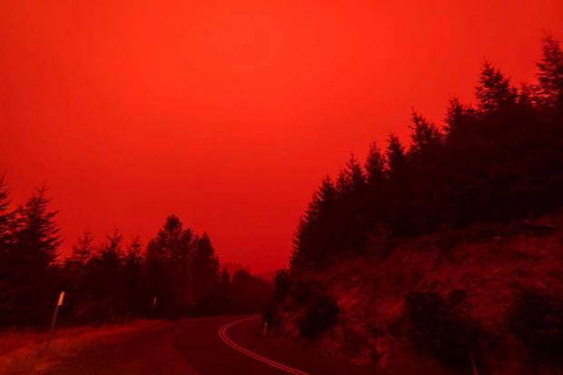 Red sky and thick smoke are seen in Salem City