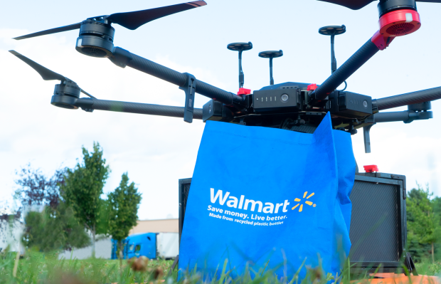 A Flytex delivery drone with a Walmart bag