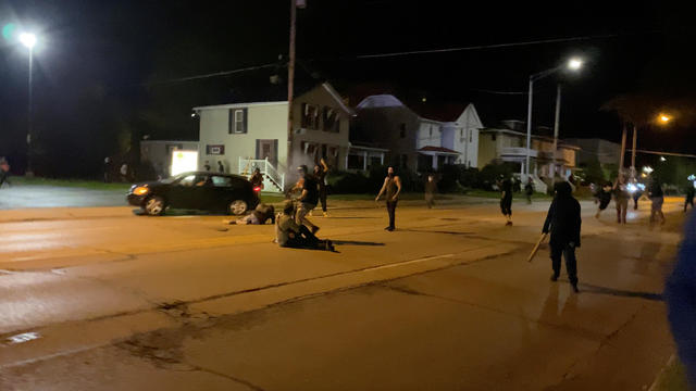 A man is being shot in his arm during a protest following the police shooting of Jacob Blake, a Black man, in Kenosha