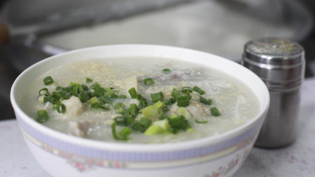"This image shows a signature congee by Congee and Noodies shop owner "" Sai Chu "", is seen a congee, chinese rice porridge in a bowl,  street food stall at Lung Mun Oasis in Tuen Mun.  25MAY16   SCMP / May Tse"
