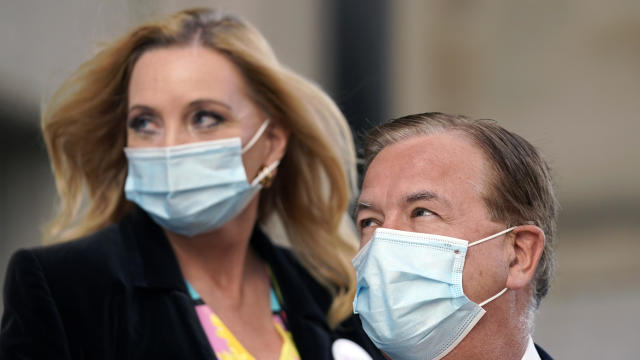 Mark and Patricia McCloskey leave a courthouse following a hearing October 14, 2020, in St. Louis.